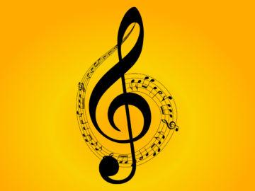 Clé de sol noir avec danse de notes de musique sur fond orange